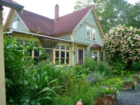 This house is so sweet with its English garden out front.