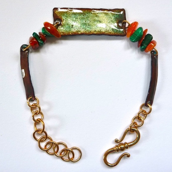 I love this translucent glaze on this bracelet. © Larry Knox. Copper, enamel, semi-precious stone, bronze. $80.